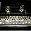 Mixing desk with speakers — Stock Photo