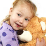 Little girl hugging a teddy bear — Stock Photo #6073158