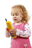 Little girl playing with phone — Photo