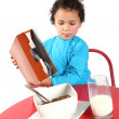 Little boy pouring breakfast cereal — Stock Photo #6129213