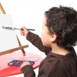 Stock Photo: Little boy painting