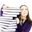 Woman preperaing for exam with toons of books - Stock Photo