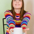 Woman sugest cup of tea — Stock Photo #5556529