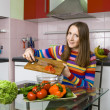 Young woman prepearing salad — Stock Photo #5556532