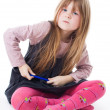 Little girl sit with felt pen with intense face — Stockfoto