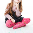 LIttle girl thinking and drawing — Stock Photo