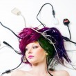 Woman lay on the floor with wires and plugs - Foto Stock