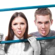 Couple with stick out tongues — Stock Photo