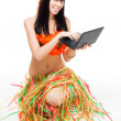 Native woman in bikini with laptop — Stock Photo