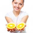 Happy young woman offer orange — Stock Photo #5557187