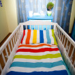 Stock Photo: Nursery room and baby cot