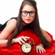 Attractive girl with alarm clock — Stock Photo #5557745