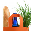 Shopping bag with bread, bottle and greenery — Stock Photo