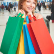 Shopping girl holding bags — Stock Photo