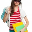 Stylish teenage girl with books — Stock Photo