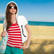 Stylish teenager on a shore — Stock Photo