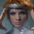 Serious clever woman in glass mask — Stock Photo