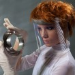 Futuristic woman examine metal detail — Stock Photo #5558636
