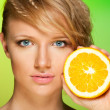 Beauty shot of a woman with orange — Stock Photo #5558775