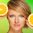 Juicy oranges and beautiful woman — Stock Photo