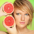 Stock Photo: Portrait of young attractive woman with grapefruit