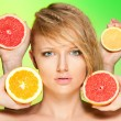 Stock Photo: Portrait of woman with fruits