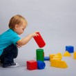 Kid playing with blocks — Stock Photo