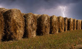 Haystacks in the field during the thunderstorm — Stock Photo
