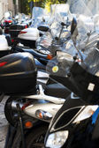 Motorcycles parked on the street — Stock Photo