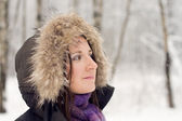 Woman in forest with fur hood — Stock Photo