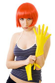 Woman in red wig and yellow gloves — Stock Photo
