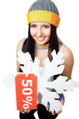 Woman hold snowflake with sale tag — Stock Photo