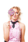Woman with lollipop in pink dress — Stock Photo