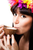 Face of a young woman drink coconut milk — Stock Photo