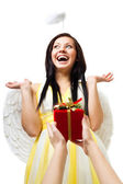 Amazed angel with wings and nimbus — Stock Photo