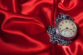 Old clock on red background — Stock Photo
