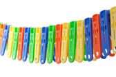Colorful row of clothes pegs — Stock Photo