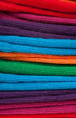 Colorful clothes in a stack — Stock Photo