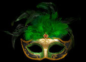 Green Venetian mask on black — Stock Photo