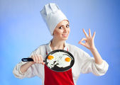 Chef with pan and frying egg — Stock Photo