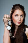 Kobieta z kieszeni zegary — Zdjęcie stockowe
