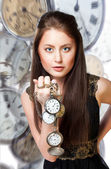 Woman with pocket watches — Stock Photo