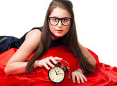 Attractive girl with alarm clock — Stock Photo