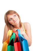 Thinking woman with colorful bags — Foto de Stock