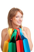 Happy young customer after shopping — Stock Photo