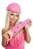 Blondie woman with pink tool — Photo