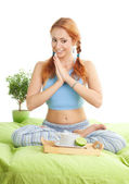 Yoga woman having a tea — Stock Photo
