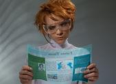 Beautiful woman with flexible hi-tech display — Stock Photo