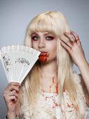 Vampire blond girl — Stock Photo