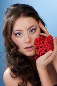 Beautiful woman with rowan berry — Stock Photo